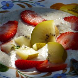 Healthy buckwheat and linseed porridge with banana and fruit.